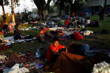 A Central American migrant, moving in a caravan through Mexico, looks on at a shelter, in Irapuato