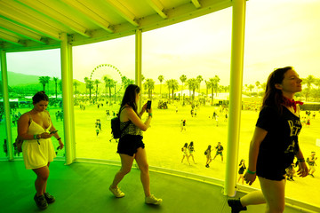 "Concertgoers walk inside an installation called ""Spectra"" at the Coachella Valley Music and Arts Festival in Indio"