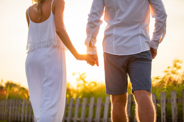 Couple walking in sunset