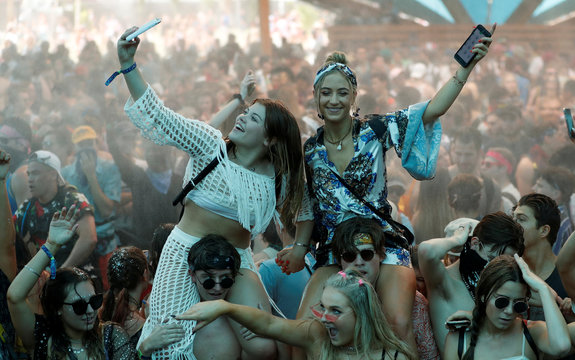 Concertgoers dance at the Do LaB stage at the Coachella Valley Music and Arts Festival in Indio