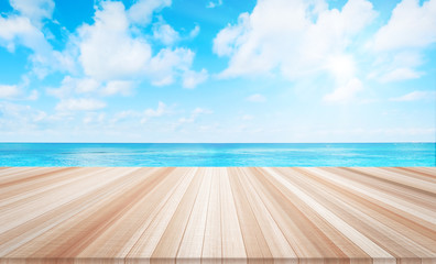 Design concept - Empty wood table top with sea and cloud background for display or montage product