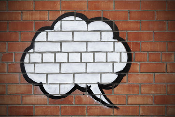 Speech bubble on the wall of red bricks.