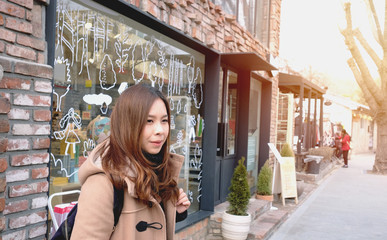 Young woman tourist in brown overcoat travel to Seoul, South Korea