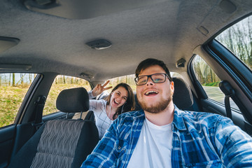 couple making selfie in car. car travel concept.