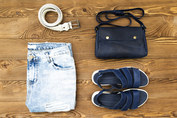 Set of stylish casual clothes for woman on wooden background, top view. flat lay