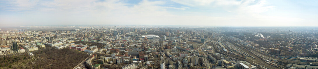 Panoramic photo of the city of Kiev with the stadium Olympic against the blue sky.