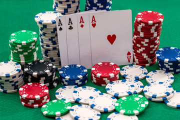 poker card and different chips on green table