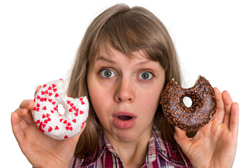Attractive woman is choosing between two donuts