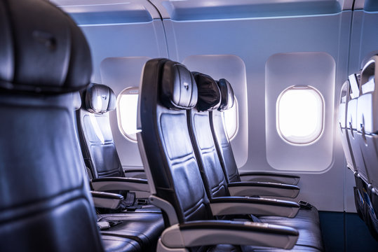 Airplane interior, seats and window. Air traffic conceptual photo