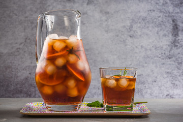 Iced peach tea in jug