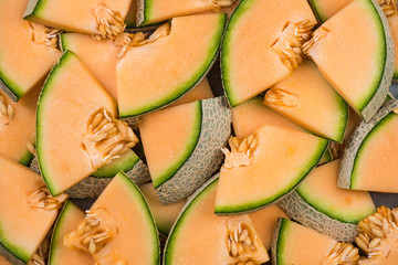 Cantaloupe melon slices, full frame food background