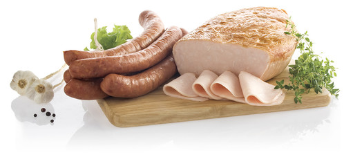 Sausage, piece of chicken ham and slices on bord isolated on white background