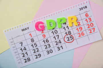 General data protection regulation on a paper background and a calendar with the date May 25, 2018
