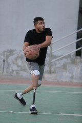 Hussain Al Howicom, a Saudi born with congenital amputation, plays basketball in Dammam