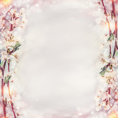 Beautiful spring background with cherry twigs blossom, frame