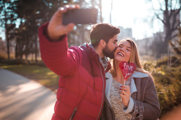 Young couple is taking selfie to show everyone that they are in love