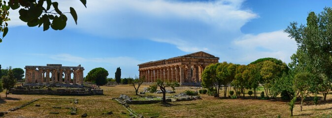 Tuinposter Athene Paeustum, Campania region, Italy 18 August 2016. Panoramic photograph in large format of the archaeological site of Paestum, also called Poseidonia. Intense sun, blue sky with white clouds.