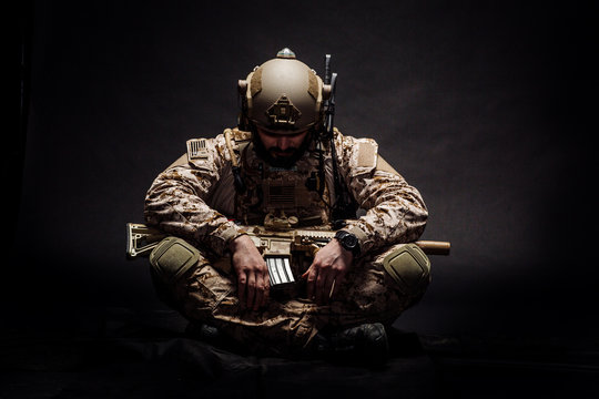 Special forces United States soldier or private military contractor. Image on a black background.