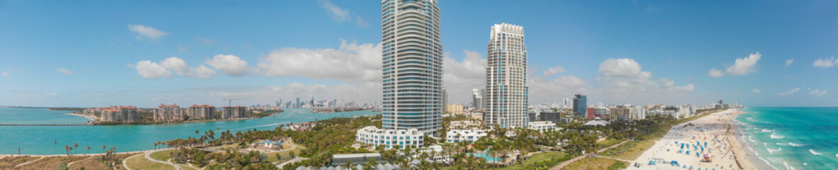 Wall Mural - Aerial panoramic sunset view of South Beach with park and buildings and beach - Miami, Florida