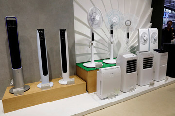 Electric fans made by Chinese appliance manufacturer Gree are display during the China Import and Export Fair, also known as Canton Fair, in the southern city of Guangzhou