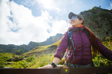 Image of woman in sunglasses against of mountains