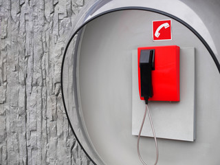 Picture of red phone on wall of modern building