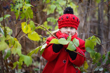 little girl in red coat and in a red hat
