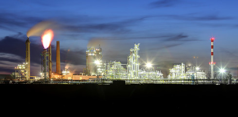 Petrochemical plant at night, oil and gas industrial