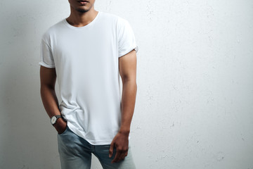 asian man in white blank t-shirt, grunge wall, studio close-up, casual style