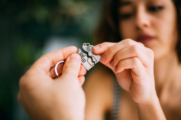 Young couple with keys of new house