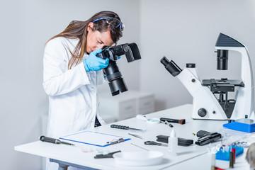 Forensic scientist examining murder weapon