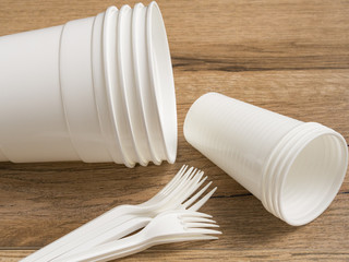 Plastic ware on wood background