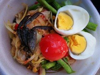 papaya spicy salad with black crab of rice farm and egg boiled