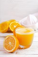 Squeezed orange juice and fresh oranges fruits.