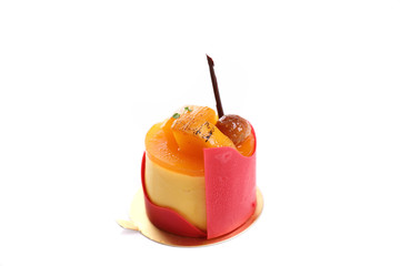 Mango fancy cake with strawberry chocolate isolated in white background