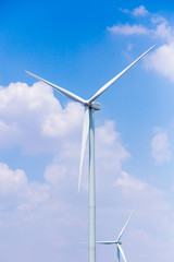 Windmills for electric power production with blue sky