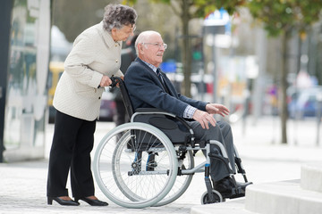 senior couple in wheelchair enjoying a day in the city