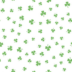 Seamless pattern with clovers leaves. Vector.