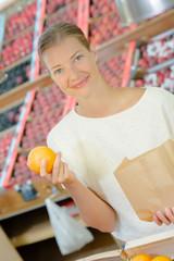 Lady holding an orange