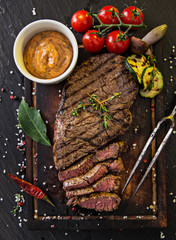 Delicious beef rump steak on wooden table