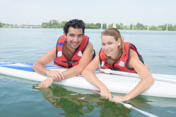 couple paddling on vacation