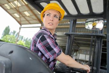 Woman reversing forklift truck