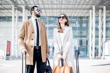 Business couple near the airport