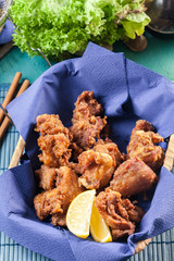 Crispy chicken karaage in basket