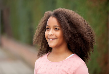 Portrait of beautiful girl with afro hair in a park