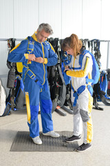 putting on the skydiving equipment