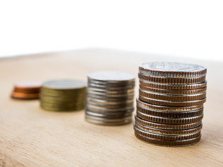 coins and money for finance and banking  on wood white background