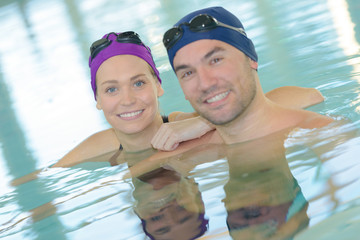 Portrait of man and woman in swimming pool