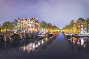 Canals of Amsterdam. Moody night panorama of Rossebuurt district