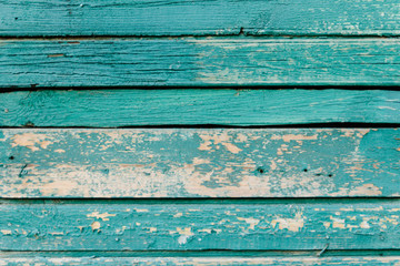 Green background of weathered painted wooden plank